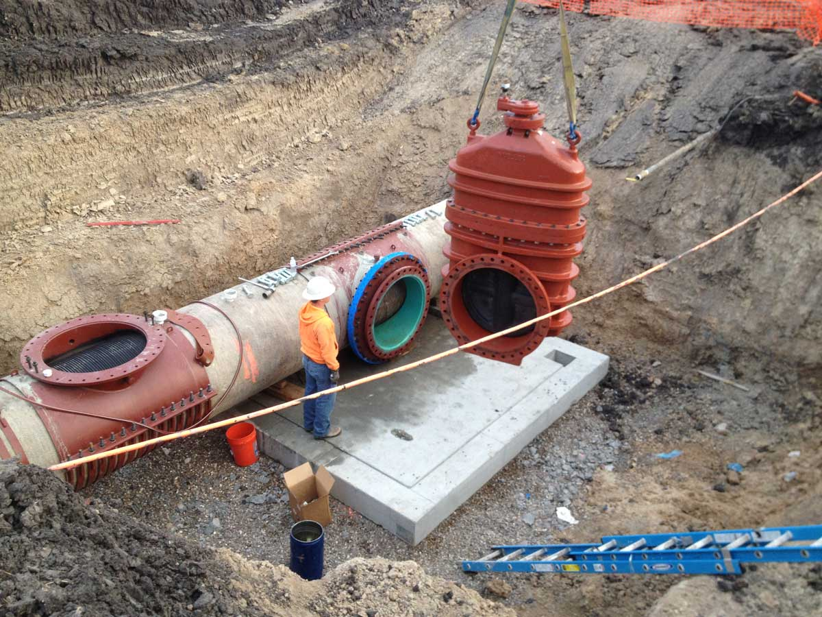Placing the huge 36inch Mueller valve onto the fitting
